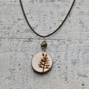 wood burned tree necklace with green stone bead