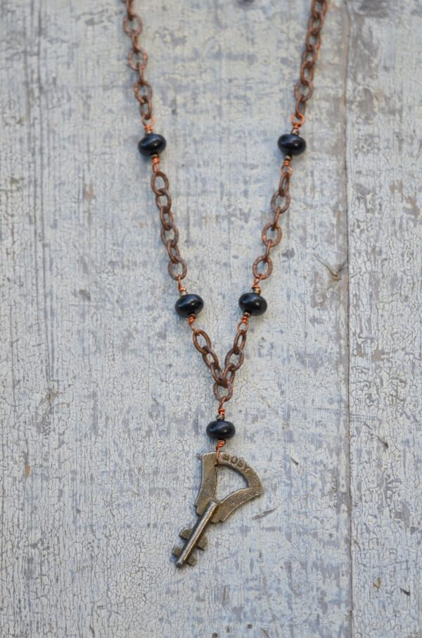 antique key necklace with copper chain and brown gemstones