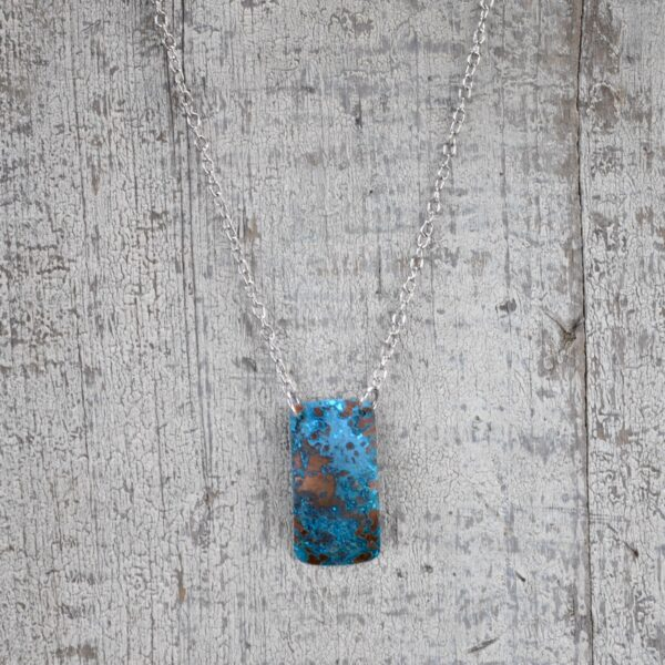blue patina vertical rectangle necklace white background