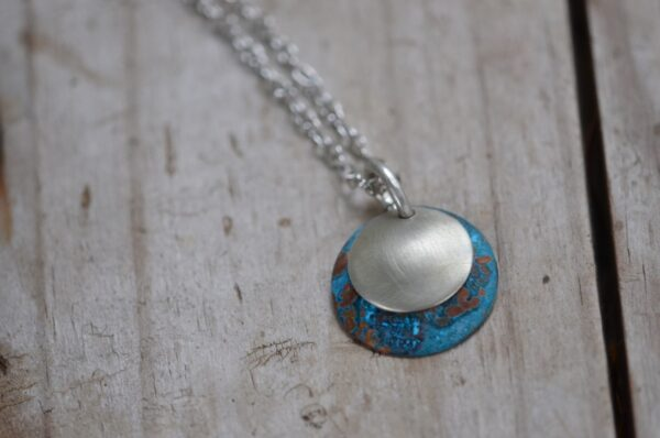 blue patina dome necklace with brushed nickel overlay necklace close up