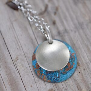 blue patina dome necklace with brushed nickel overlay necklace close up square