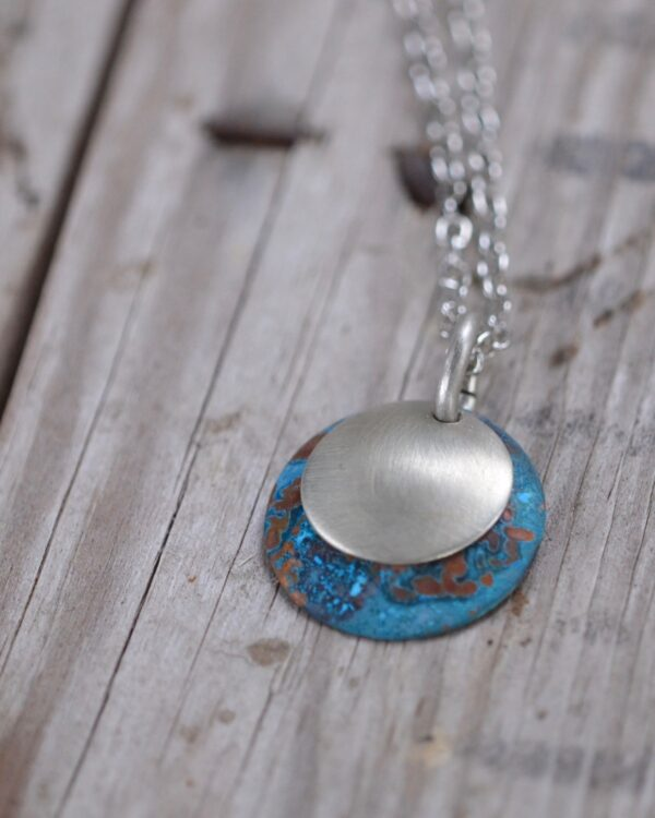blue patina dome necklace with brushed nickel overlay necklace vertical image on wood