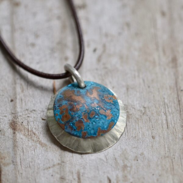 blue patina overlay on textured brushed nickel dome leather necklace detail