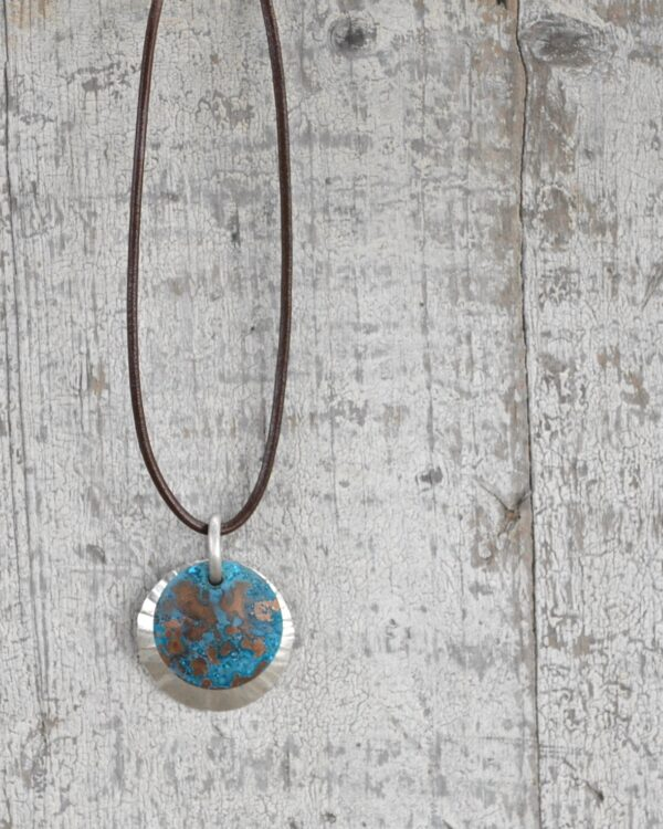 blue patina overlay on textured brushed nickel dome leath necklace vertical image on white