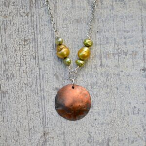 copper dome necklace with yellow and green pearls