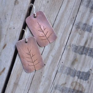 copper tree earrings on wood