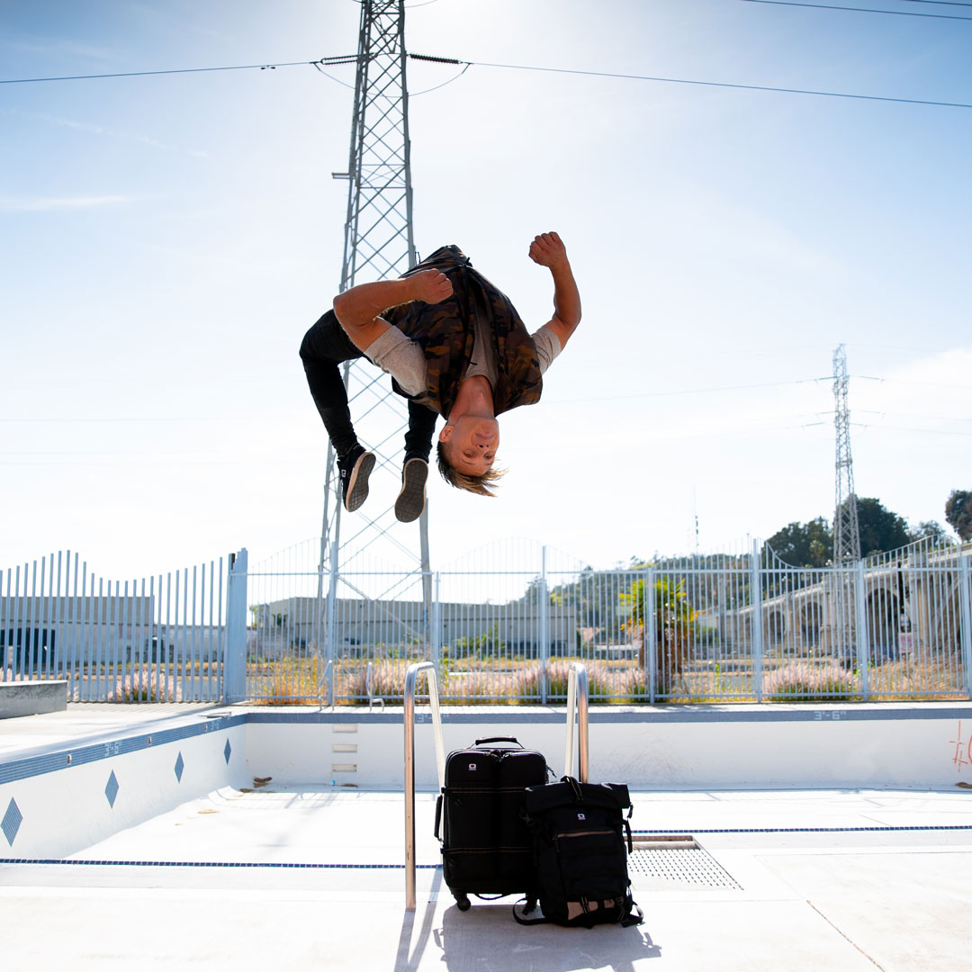 OGIO Live Your Go's Pasha Petkuns doing a flip next to an abandoned empty pool