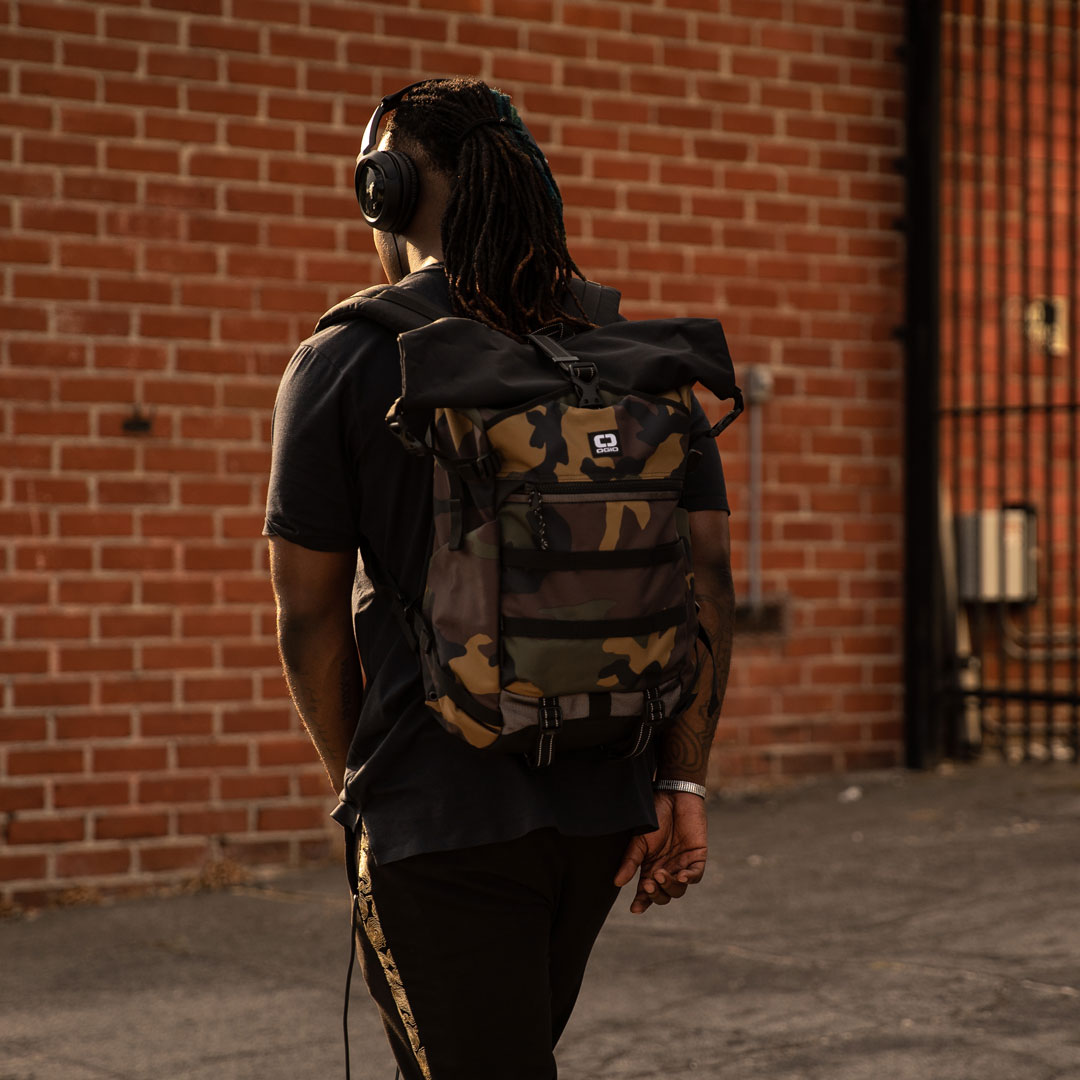 OGIO Live Your Go's Will Adams walking in OGIO backpack