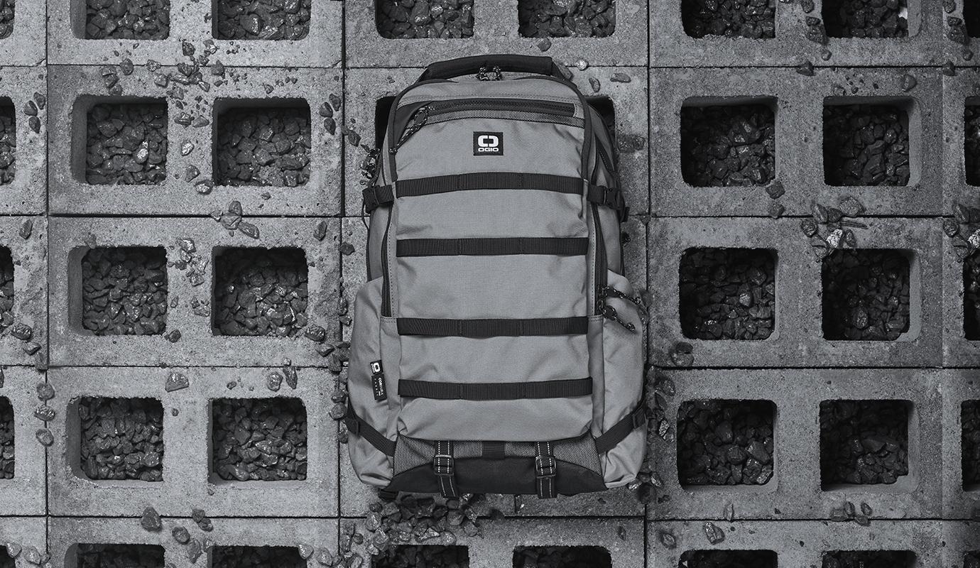 OGIO Charcoal backpack on gray cinder blocks