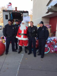 Santa with Westland Police Officers posing for a picture during the Stuff A Swat Event at Target