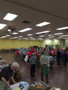 Volunteers bagging up donated toys and items