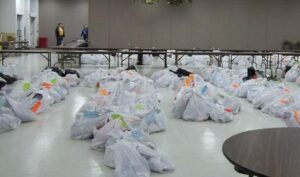 Garbage bags filled with Christmas gifts for families