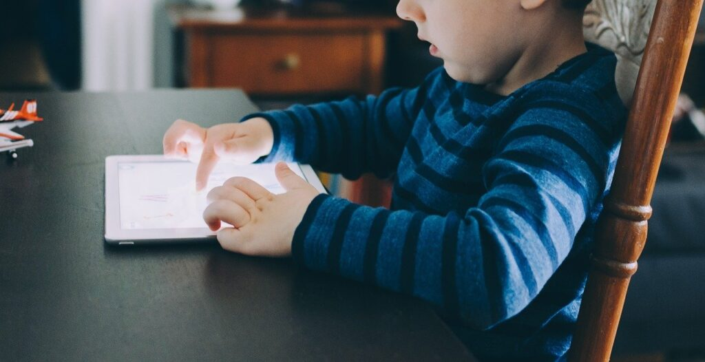 young child with iPad