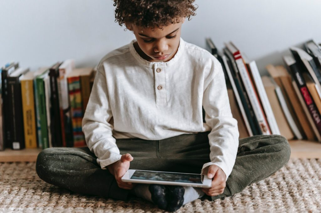child playing video game on tablet