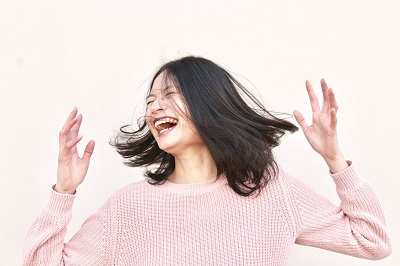 Laughing woman Photo by gabrielle cole on Unsplash