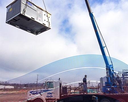 Technician Moving Shipment with Crane