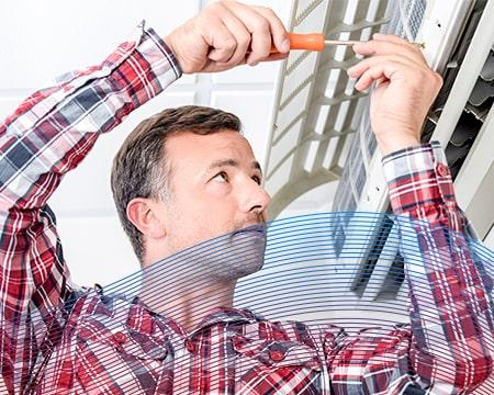 Technician Adjusting A/C Screw