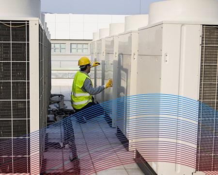 Technician Servicing Commercial Units