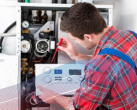 Technician Calibrating Boiler