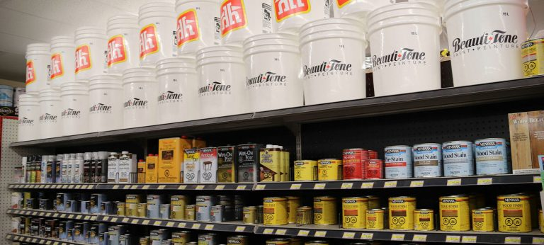 A shelf of paint and stain products