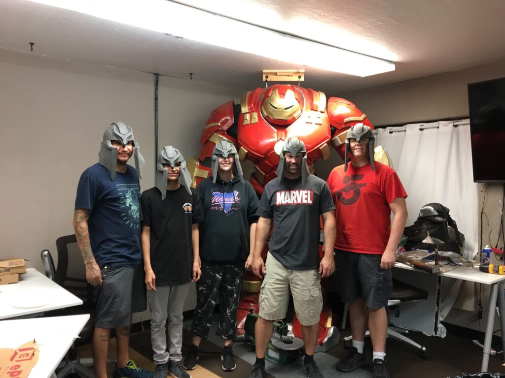 a group of folks wearing the foam warrior helmets they just made in our foamsmithing 101 class