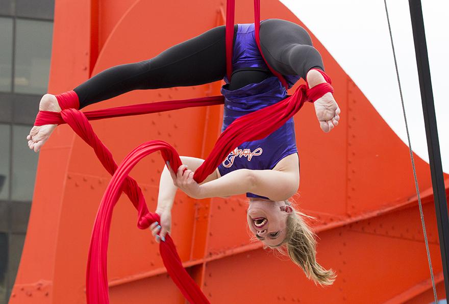 Amelia Performing on Aerial Silks at Caldar Plaza in Grand Rapids, Michigan during Pride June 2019.