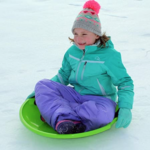 Flexible-Flyer-3-pack-Snow-Saucer-Sleds child in snow