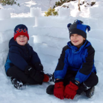 Flexible-Flyer-Snow-Fort-Building-Kit-Brick-Form-Sand-Castle-Mold-Block with kids playing in snow