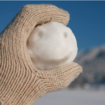 Hey-Play-Snowball-Maker-Tool-with-Handle holding snowball
