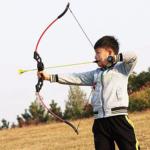 SinoArt-4722-Bow-and-Arrow-Set boy shooting bow