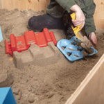Superio-Sand-or-Snow-Play-Toy-Set child playing in sand