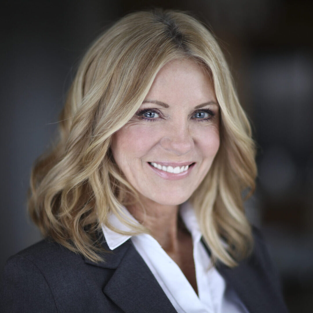 Portrait Of A Mature Businesswoman Smiling At The Camera