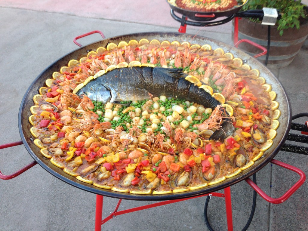 Salmon Paella with green lip mussels, clams, whole prawns and scallops.