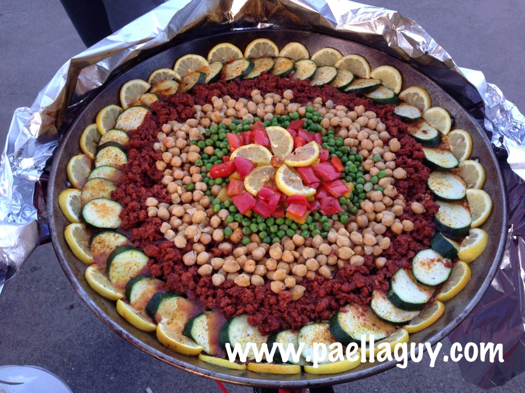 Paella Guy's helper Flor makes a dazzling vegetarian gluten free paella with soy chorizo.