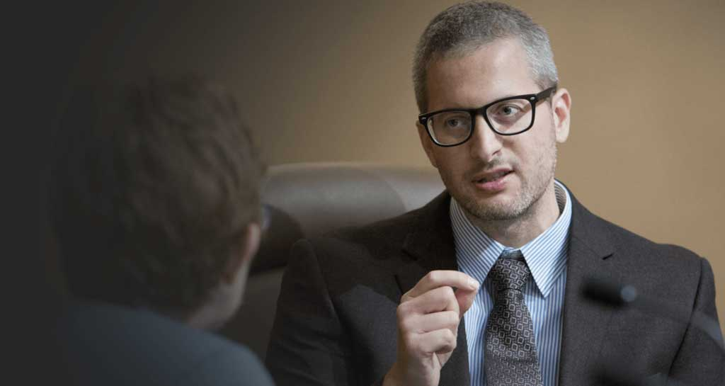 image of lawyer talking with client