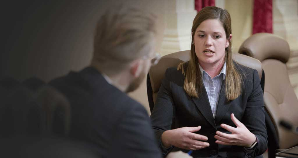 image of attorney talking with client