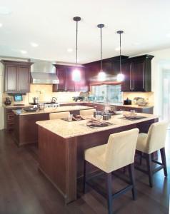 kitchen with dark brown flooring and cabinets