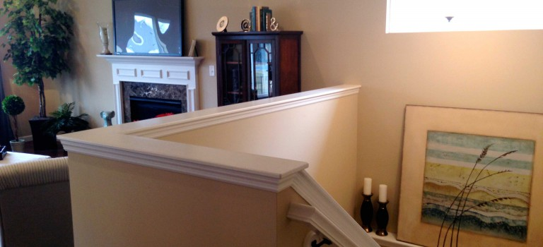 great room with half wall staircase