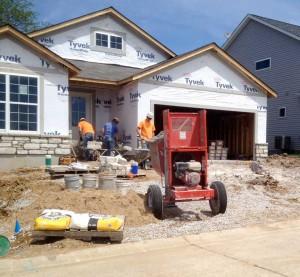 crew installing stone