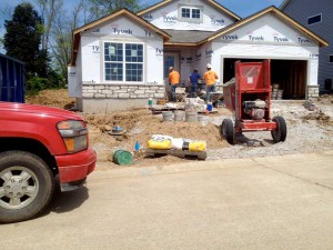 installing stone to the front of the home