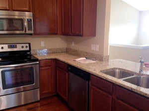 granite and appliances installed in kitchen