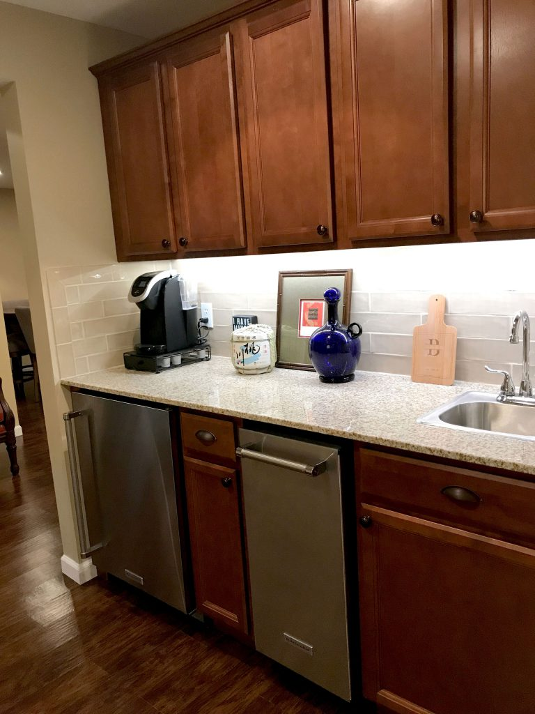 lower level wet bar with matching cabinets and pulls