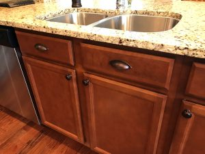 drawers under sink with pulls