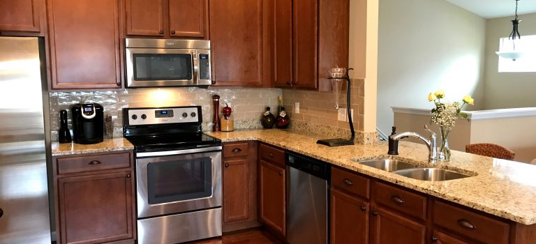 kitchen cabinets with new pulls and knobs