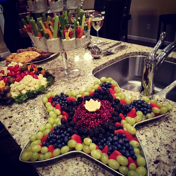 A fruit and vegetable tray on a kitchen island.
