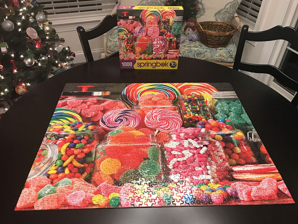 A completed puzzle with different candies printed on it.
