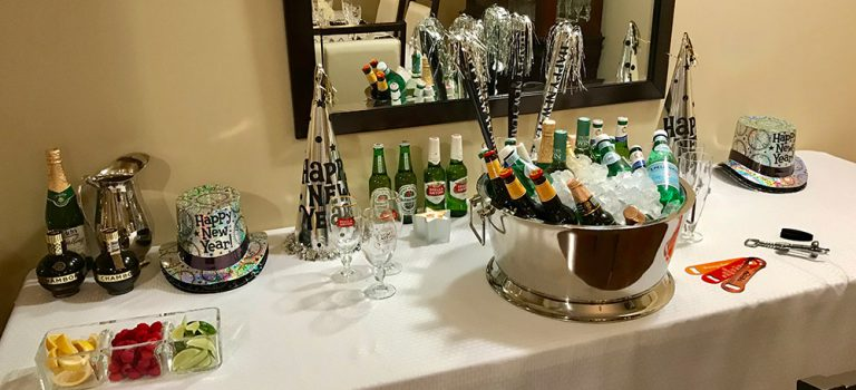A table full of drinks for a New Year's Eve Party.