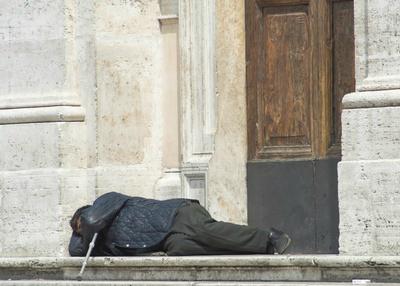 Homeless disabled man sleeping