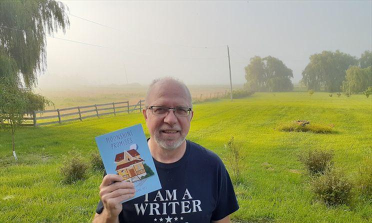 John Van Rys holding Moonshine Promises in the foggy front yard of his rural Ontario hobby farm. Photo by April Van Rys