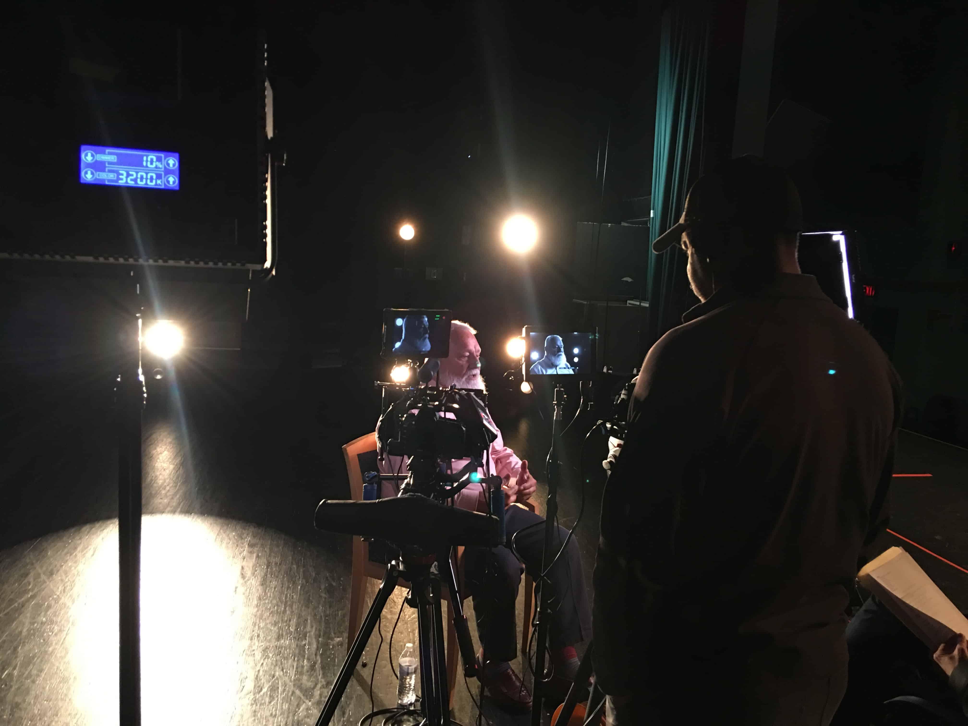 Photo of director Freddy Rodriguez shooting Gary Keating